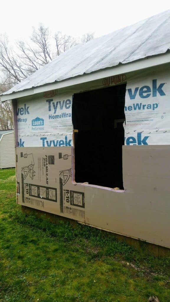 she shed with large hole cut out for a window