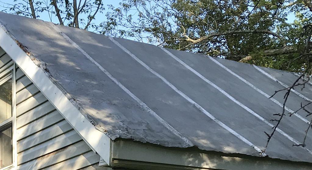damaged tin roof corner