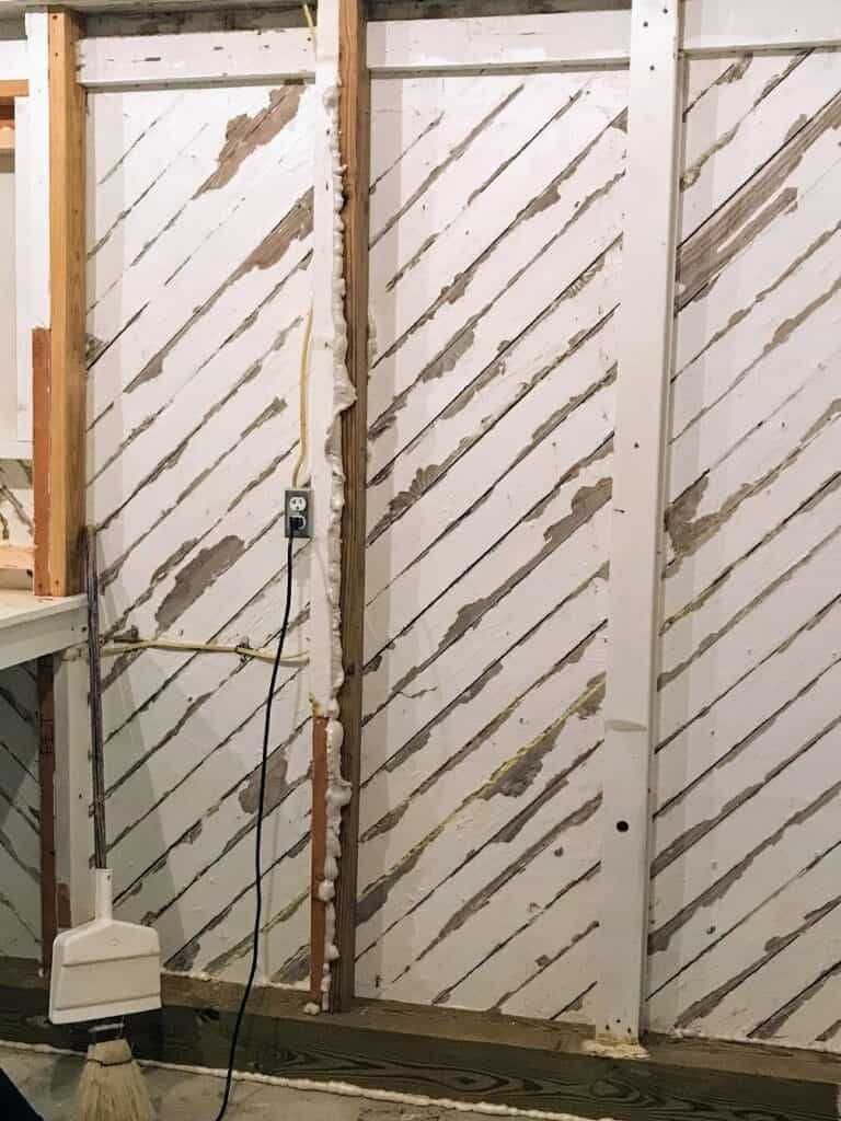 wood slat walls with gaps between boards and spray foam