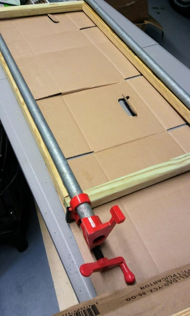 pipe clamps on 2 inch wood window frame