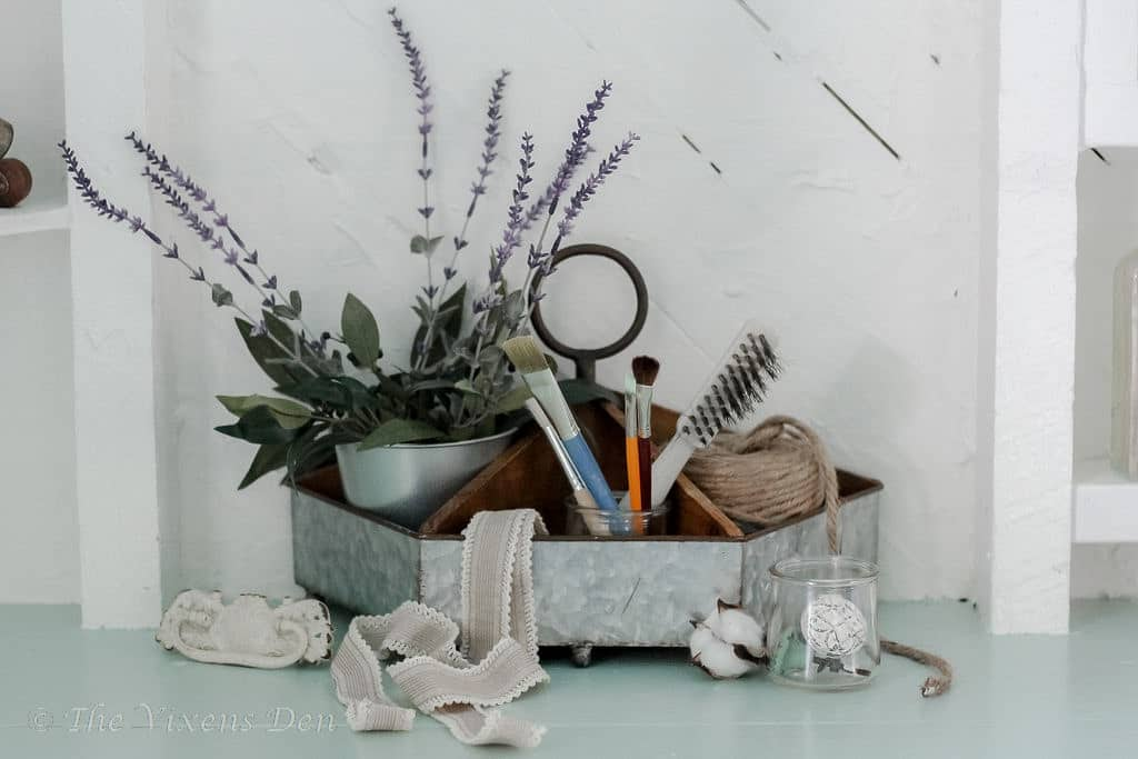 organizer with lavender stalks, paintbrushes, jute cord, and hardware