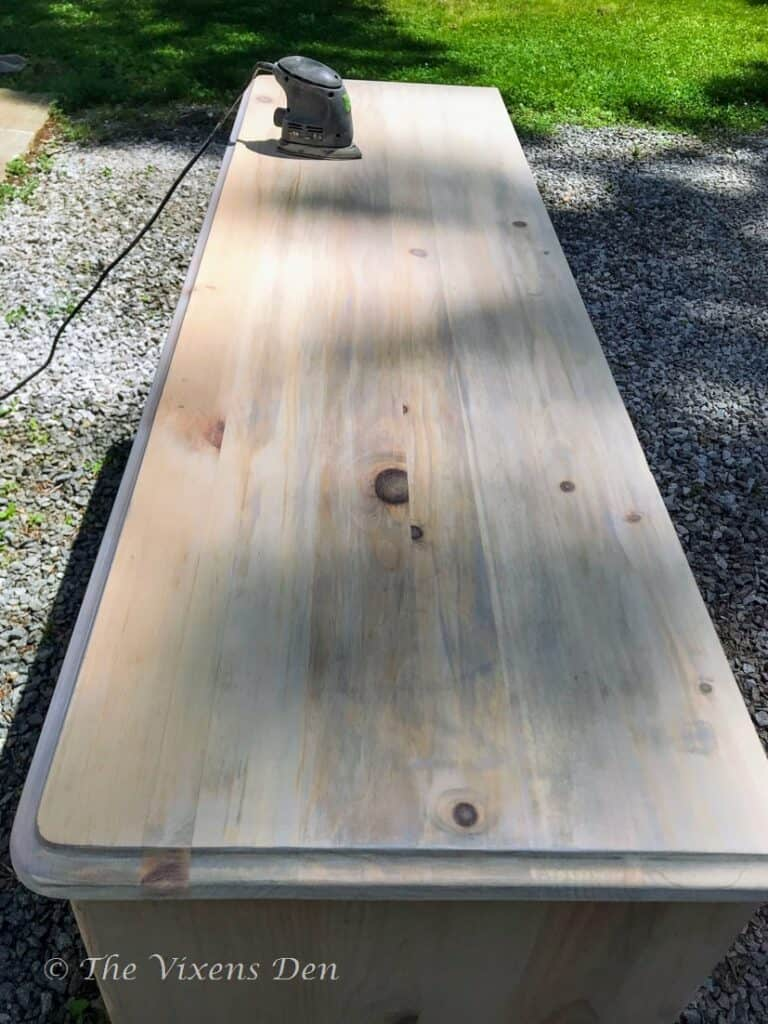 dresser top with blotchy stain