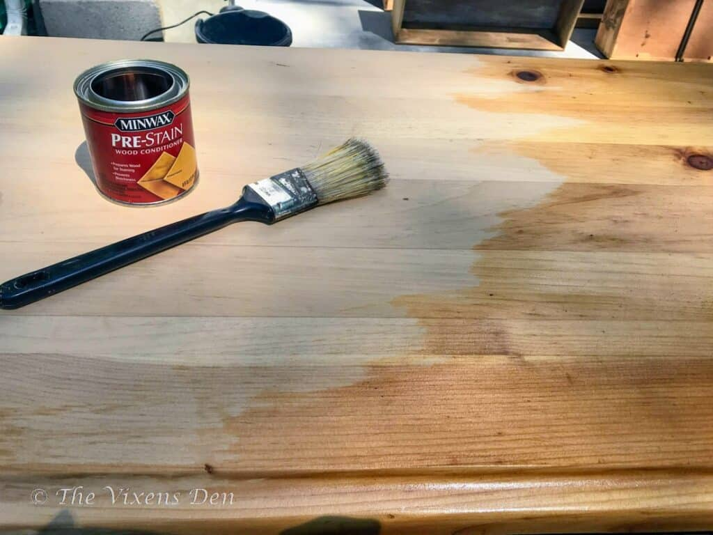 dresser top with wood conditioner partially applied