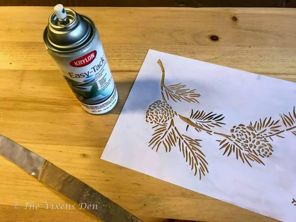 krylon easy-tack spray adhesive and a pine bough stencil