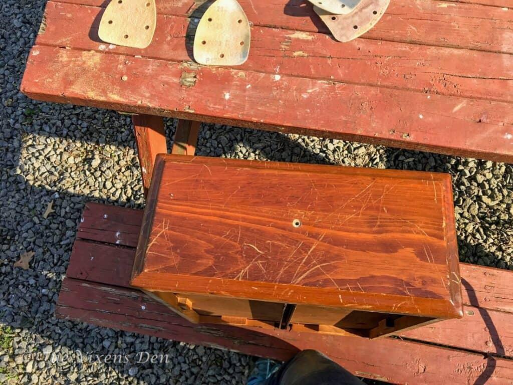 orange dresser drawer front with scratches