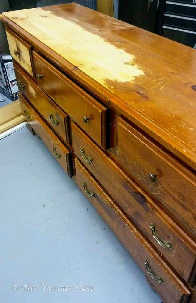 partially sanded solid pine dresser with orange finish