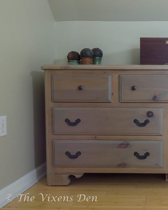 natural wood stained dresser with black matte hardware