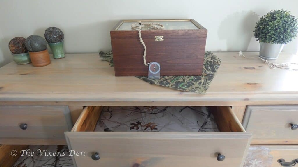 raw wood stained dresser with camo drawer lining