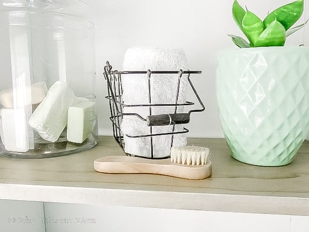 linen cabinet shelf with pretty storage
