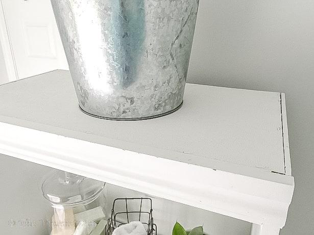 linen cabinet shelf top