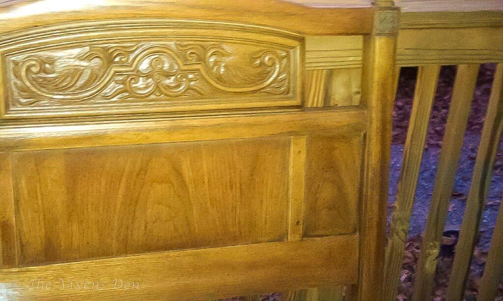 closeup of unpainted vintage headboard