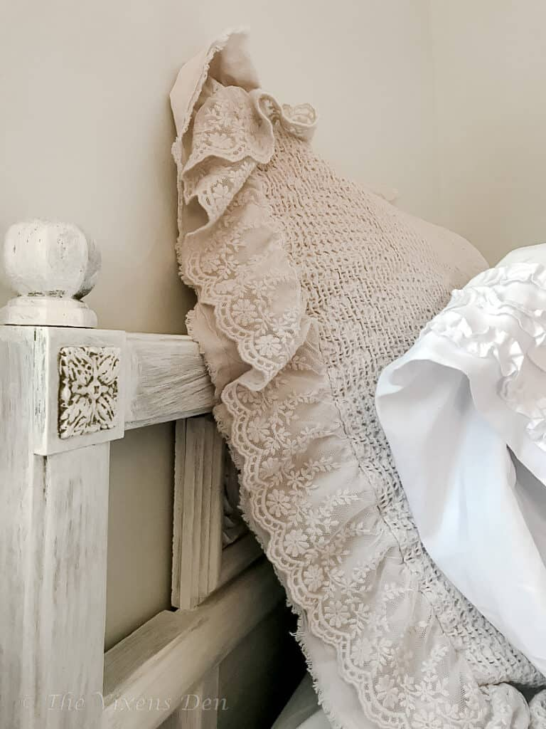 finished 80's headboard makeover styled with lacey pillows