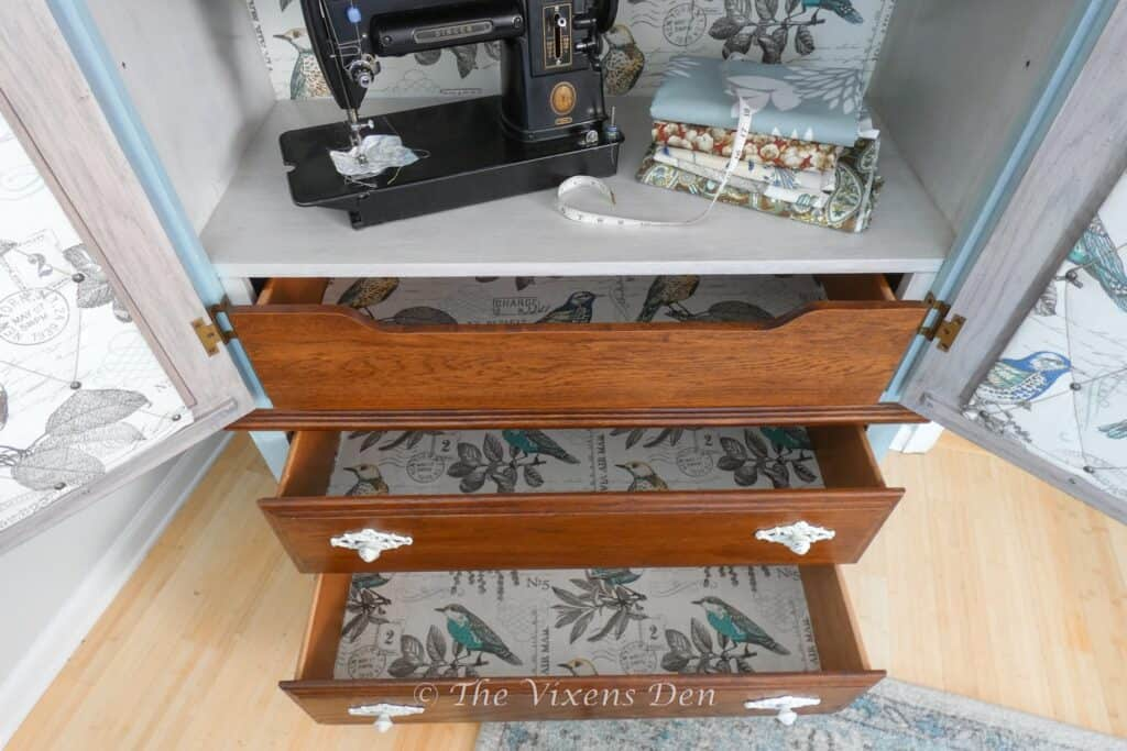 fabric lined drawers installed with mod podge