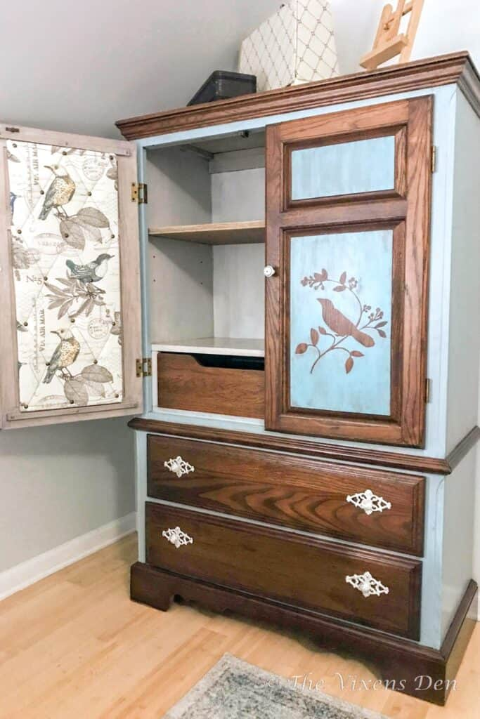 paint washed and stained armoire with fabric covered cork board