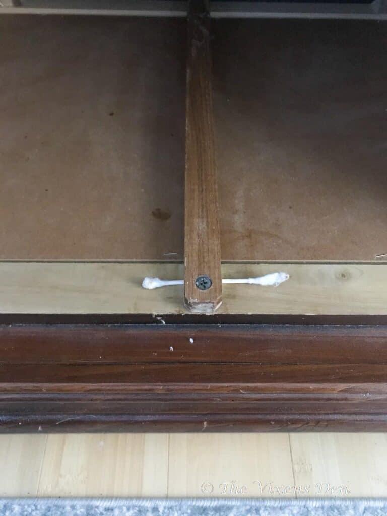 cotton swab shim under case drawer slide