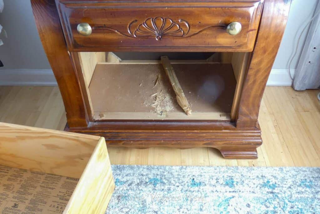 nightstand with damaged drawer slide