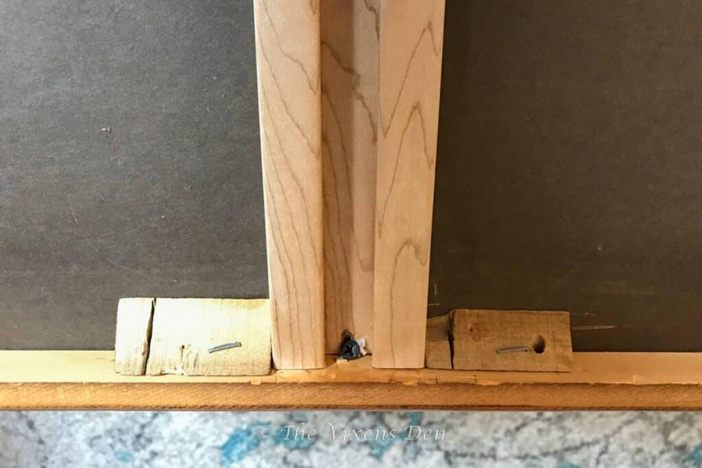 drawer slide with split around the screw
